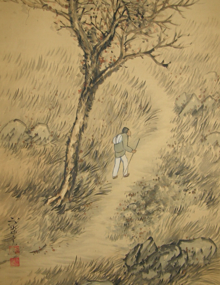 Man Walking on Mountain Trail